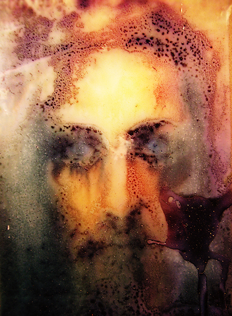Jesus image altered by decades of exposure to candles, wax and smoke.