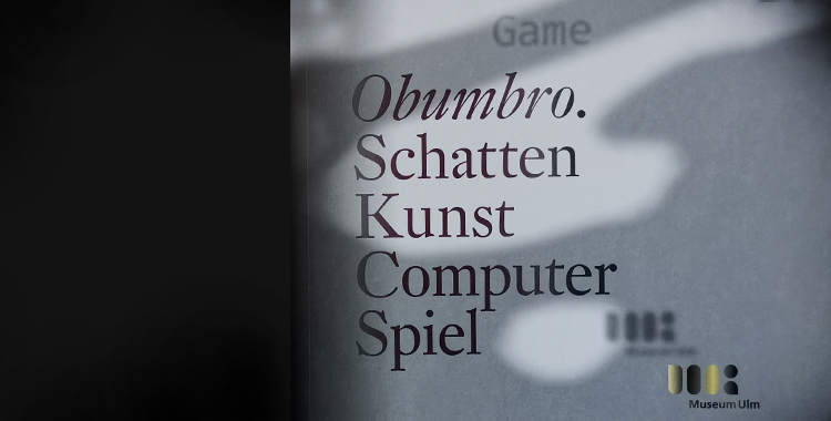 Section of the catalogue's cover, black typography on greyish background.