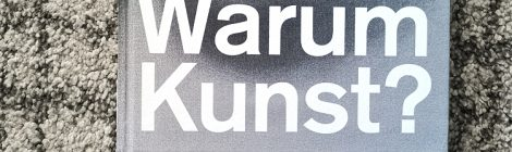 """Lower left section of the catalog """"Warum Kunst"""", white typography on black and white drawing."""