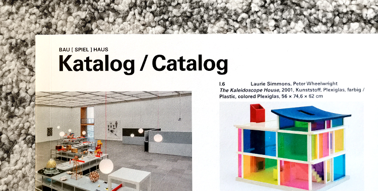 Top left section of the cover of the exhibition catalog Bau Spiel Haus.